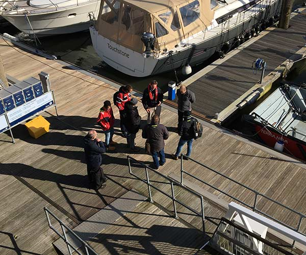 Marina professionals under instruction